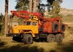 Тягач лесовозный Урал-4320 с гидроманипулятором
